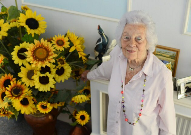 Grandmother and sunflowers