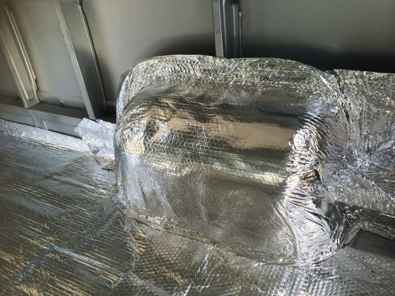 making-the-van-floor-donkey-van-conversion-06-foil-insulation-difficult-shapes